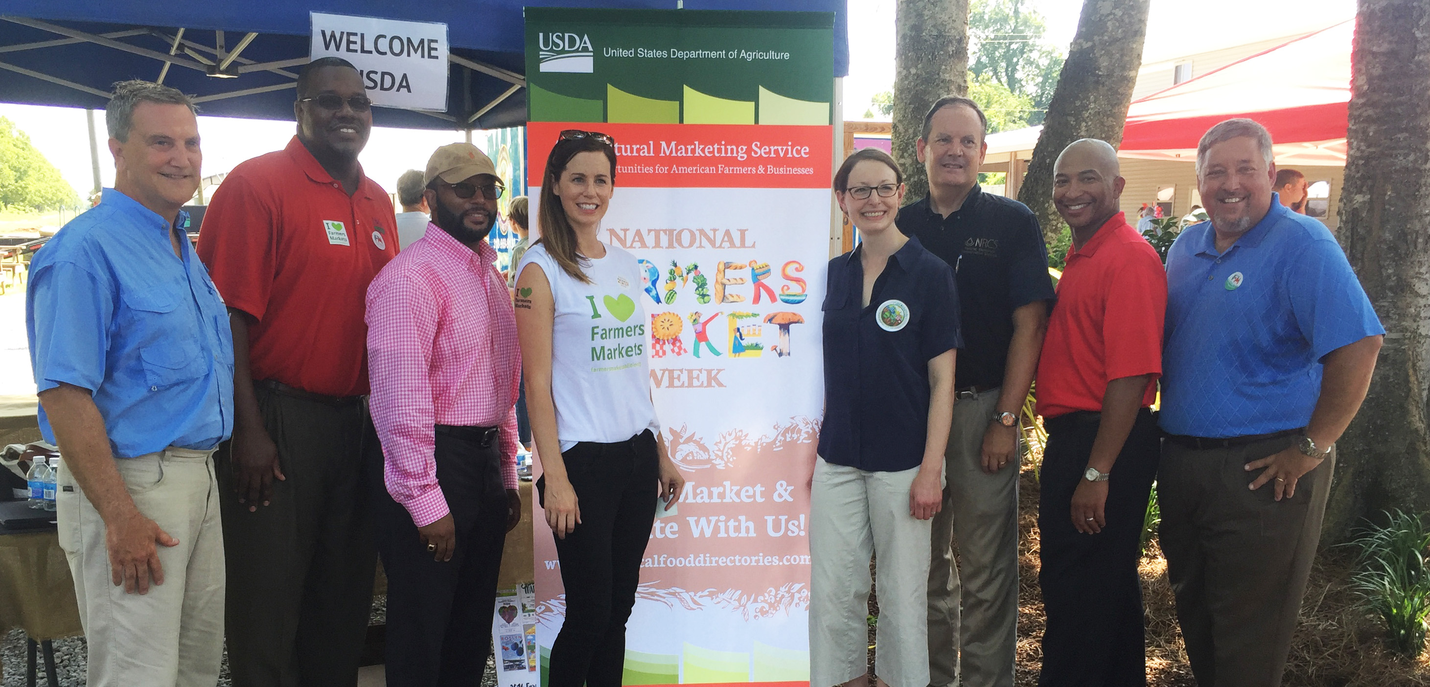 Inglewood Market Manager Lee Weeks, Lee Jones of USDA Rural Development, Arthur Neal of USDA AMS, Jen Cheek of FMC, Elanor Starmer of USDA AMS, Kevin Norton of USDA NRCS, Michael Johnson of USDA AMS, and Craig McCain of USDA Farm Service Agency at the Inglewood Harvest Barn Markt