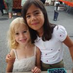 Kids smile at farmers market